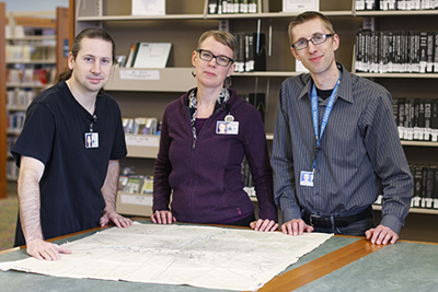 Multnomah County Library's map team: Baron Schuyler, Emily-Jane Dawson, and Ross Betzer.  Photo by Jayson Colomby.